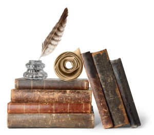 Old books, inkstand and scroll isolated on white